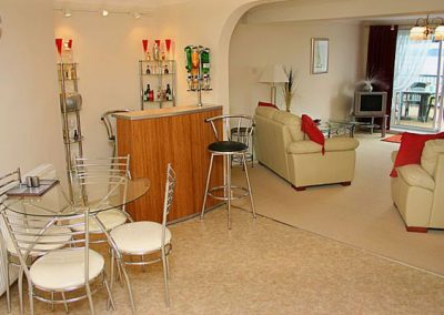 The living area with mini bar @ 11 Sunhill Apartments