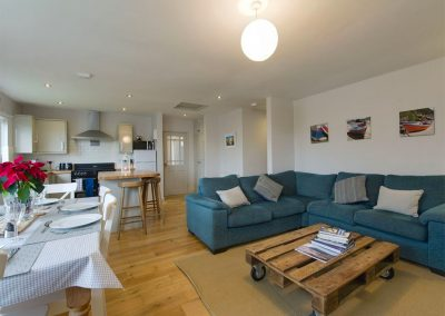 The open-plan living area at 12 Atlantic Close, Widemouth Bay