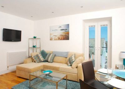 The open-plan living area at 14 At The Beach, Torcross