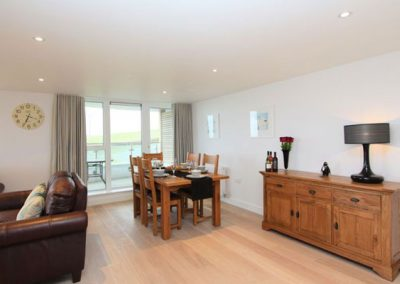 The open plan living and dining area @ 23 Ocean Gate, Newquay
