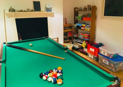The games room at 24 Victoria Road, Topsham