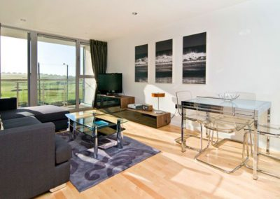 The living area has views over the golf course towards Fistral Bay
