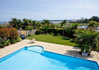 The shared swimming pool & garden at 3 Goodrington Lodge, Paignton