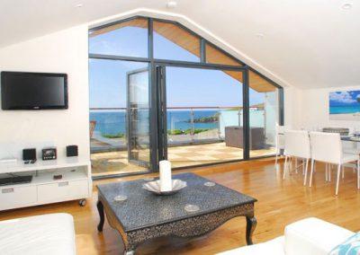 The living area @ 4 Coastguards offers panoramic sea views