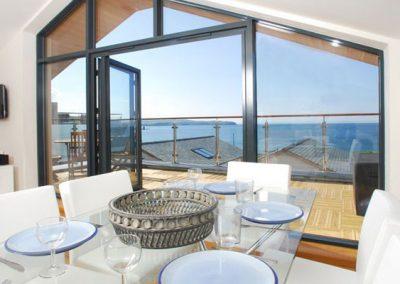 The dining area @ 4 Coastguards offers panoramic sea views
