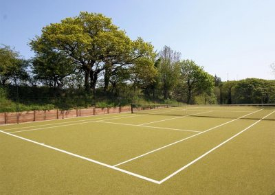 The all-weather tennis court at Hillfield Village, Bugford