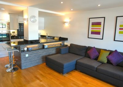 The open plan living & dining area and kitchen @ 5 Queens Quay, Torquay