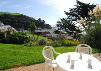 Relax on the terrace and take in the view over the beach