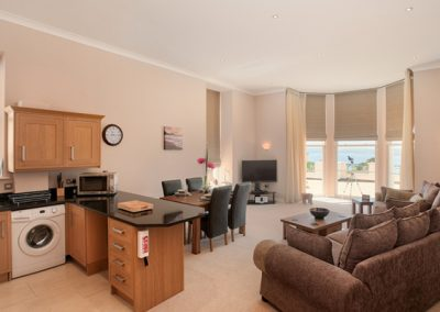 The open plan living & dining area and kitchen @ 8 The Bay, Torquay