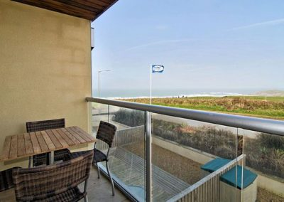 The balcony @ 8 The Vista overlooks the golf course down to Fistral Beach
