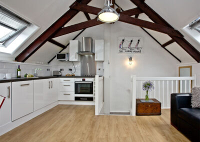 The open-plan living area & kitchen at Anchor Cottage, Strete