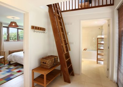 The hallway at Apple Barn, East Portlemouth with steep ladder staircase to first floor loft and second bedroom.