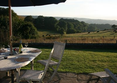 The patio and countryside view at Apple Barn, East Portlemouth