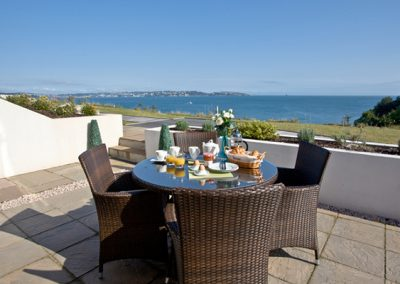 The terrace with outdoor seating @ Avocet 1, The Cove, Brixham