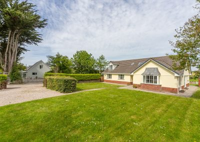 The spacious gated garden & parking area at Badgers Drift, Trebetherick
