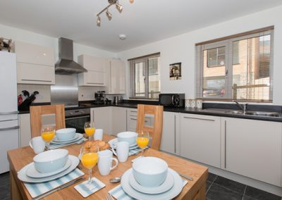 The open plan living & dining area and kitchen @ Bay View Apartment, St Austell