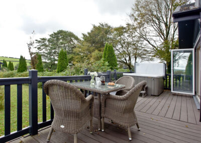 The wrap-around deck at Berrynarbor Lodge, Kentisbury Grange, Kentisbury