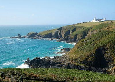 The green countryside & coastal paths surrounding Bishop Rock, Lizard Lighthouse, Lizard