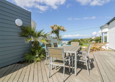 The decked patio at Blue Bay Beach House, Trenance