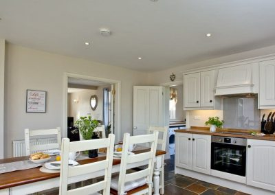 The kitchen & dining area at Brambles Cottage, Wooda Farm, Bush