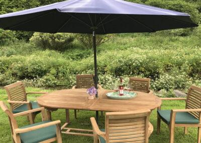 The alfresco dining area & garden at Bratton Mill Farmhouse, Bratton Fleming