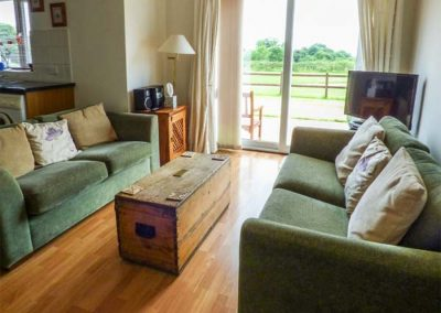 The living area at Broom Cottage, Stoneleigh Holiday Village, Weston