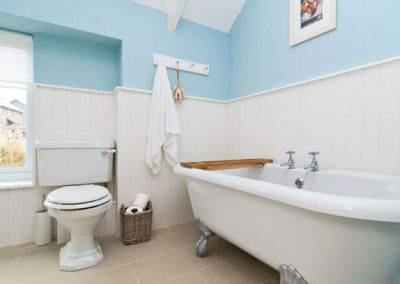 Spacious bathroom with roll-top bath @ Bryher Cottage