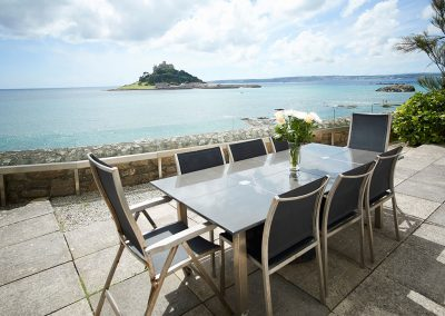 The patio at Captain's House, Marazion has a spectacular view looking out over St Michael's Mount