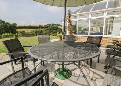 The outdoor patio at Chapel Green, Polgooth