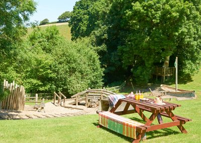 One of the picnic spots & children's play area at Gitcombe House Country Cottages, Cornworthy