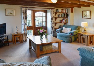 The living area at Coachmans Cottage, White Cross