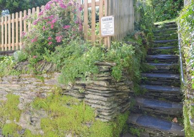 Stone steps up to the elevated garden at Cobblers Cottage, Boscastle