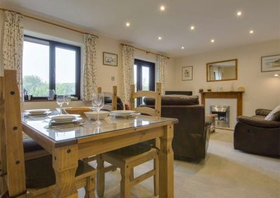 The dining area at Columbine Cottage, Poughill
