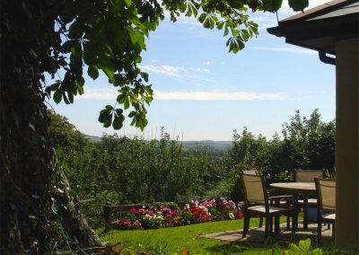 The patio and view at Columbine Cottage, Poughill