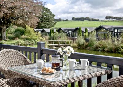 The deck & lake views at Combe Lodge, Kentisbury Grange, Kentisbury