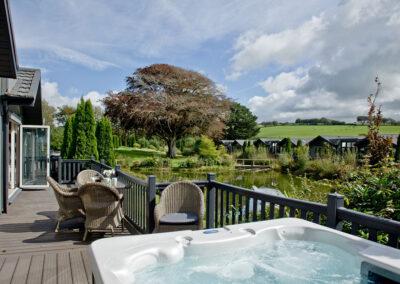 The hot tub & wraparound deck at Combe Lodge, Kentisbury Grange, Kentisbury