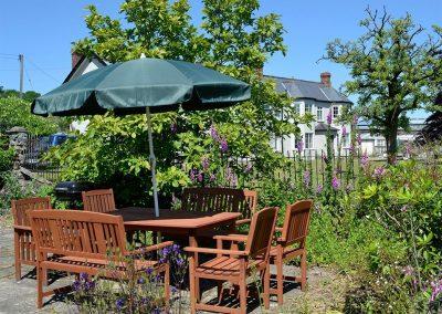 The patio & barbecue area at Conifers, Johnstone