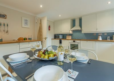 The kitchen & dining area at Curlew's Cwtch, Roserrow, Polzeath