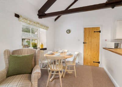 The dining area at Daisy Cottage, Old Mill Cottages, Marldon