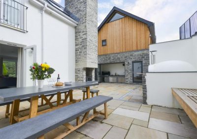 The patio & outdoor dining area at Devon Priory, Goodleigh