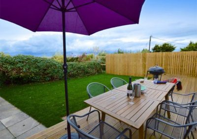 The decked patio & garden at Dinas View, Constantine Bay