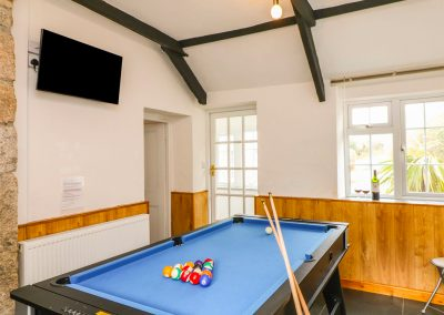 The games room at Dromore, St Breward with TV, pool table and table tennis
