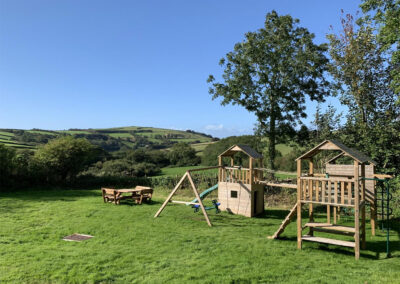 The garden & children's climbing frame at East Hill Cottage, Parracombe