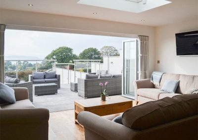The living area & upper patio at Estuary View, Hulham