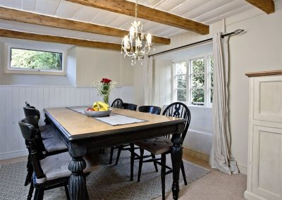 The dining area at Evies Cottage, Higher Brixham