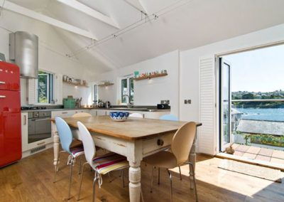 The open-plan kitchen & dining area @ Farthings with fabulous views