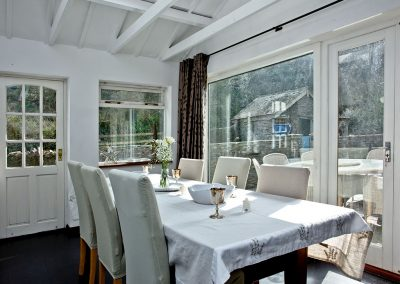 The dining area at Gara Mill Cottage, Slapton