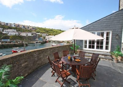 The sun-drenched patio at Glanville House, Mevagissey