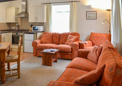 The open plan living area at Granary, Trimstone Manor Cottages, Trimstone