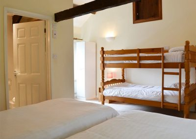 Bedroom #1 at Granary, Trimstone Manor Cottages, Trimstone